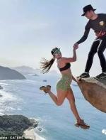 男子无保护倒挂百米高悬崖 真相让人吃惊